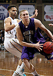 SIOUX FALLS, SD - FEBRUARY 27:  Clint Thomas #34 from the University of Sioux Falls looks to pass the ball  while being pressured by Matthew Brazendale #21 from Augustana during their NSIC Tournament game Saturday night at the Pentagon in Sioux Falls. (Photo by Dave Eggen/Inertia)