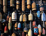 Mystic, CT<br /> Collection of lobster buoys hung on a boat house at Noank, CT