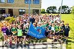 Ballyduff NS students pictured with Kerry footballer Shane Enright on his visit to the school to raise the Active School flag on Thursday.