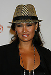HOLLYWOOD, CA. - October 03: Tia Carrere arrives at the Best Friends Animal Society's 2009 Lint Roller Party at the Hollywood Palladium on October 3, 2009 in Hollywood, California.