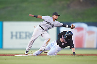 Anyesber Sivira (40) of the Augusta GreenJackets reaches for a throw as Ian Dawkins (8) of the Kannapolis Intimidators slides into second base at Kannapolis Intimidators Stadium on June 21, 2019 in Kannapolis, North Carolina. The Intimidators defeated the GreenJackets 6-1. (Brian Westerholt/Four Seam Images)