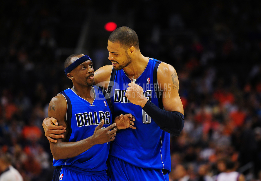 Mar. 27, 2011; Phoenix, AZ, USA; Dallas Mavericks guard (31) Jason Terry celebrates with center (6) Tyson Chandler in the closing minutes of the game against the Phoenix Suns at the US Airways Center. The Maverick defeated the Suns 91-83. Mandatory Credit: Mark J. Rebilas-