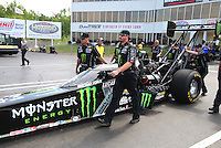 May 17, 2015; Commerce, GA, USA; Crew members wait with NHRA top fuel driver Brittany Force during the Southern Nationals at Atlanta Dragway. Mandatory Credit: Mark J. Rebilas-USA TODAY Sports