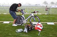 12 MAR 2010 - ABU DHABI, UAE - Rutger Beke prepares his bike in transition the day before the Abu Dhabi International Triathlon (PHOTO (C) NIGEL FARROW)