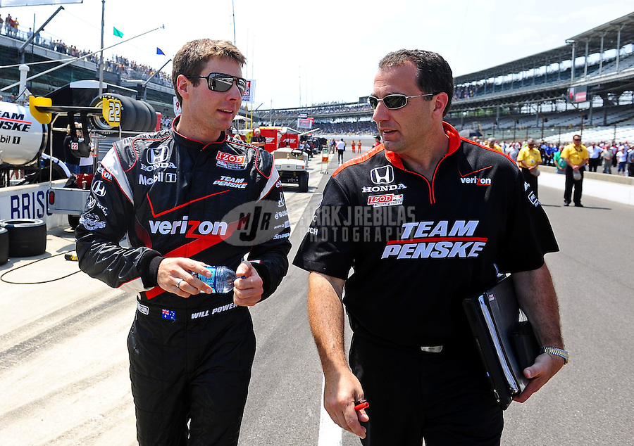 May 28, 2010; Indianapolis, IN, USA; IndyCar Series driver Will Power (left) with a crew member during carb day prior to the Indianapolis 500 at the Indianapolis Motor Speedway. Mandatory Credit: Mark J. Rebilas-