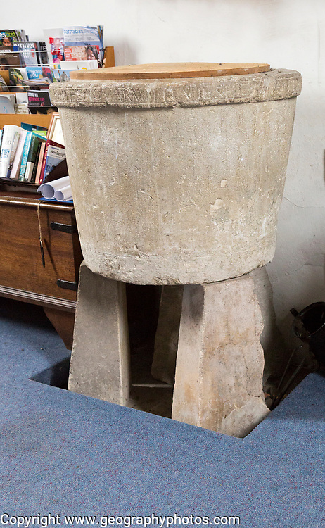Circa 10th century Anglo-Saxon baptismal font, around its rim is a Latin inscription  from Psalm 42: ìSicut cervus desiderat ad fontes aquarum ita desiderat anima mea ad te deus amenî: ìAs a deer longs for the running brooks, so longs my soul for you, O Godî inside the church at Potterne, Wiltshire, England, UK