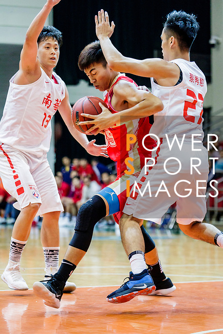 Yip Yiu Pong #35 of Nam Ching Basketball Team (C) tries to score during the Hong Kong Basketball League game between SCAA and Nam Ching at Southorn Stadium on May 4, 2018 in Hong Kong. Photo by Yu Chun Christopher Wong / Power Sport Images