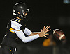 Gregory Campisi #11, St. Anthony's quarterback, takes a snap during a CHSFL varsity game against Monsignor Farrell at St. Anthony's High School in South Huntingon on Friday, Sept. 29, 2017.