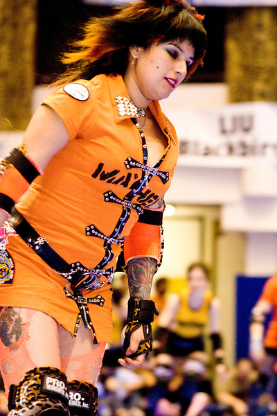 CC Bullets of the Manhattan Mayhem gets ready to clash against the Bronx Gridlock at a Gotham Girls Roller Derby bout in New York City on May 6, 2006.