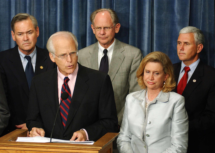 9/09/04.INTELLIGENCE OVERHAUL/SEPT. 11 LEGISLATION--Christopher Shays, R-Conn., and Carolyn B. Maloney, D-N.Y., during a news conference to introduce a bill similar to one (S 2774) introduced in the Senate by Lieberman and John McCain, R-Ariz., that closely tracks the commission's recommendations. House Majority Leader Tom DeLay, R-Texas,  said Wednesday the House would not take it up. Dennis Moore, D-Kan., Michael N. Castle, R-Del., and Mike Pence, R-Ind., look on..CONGRESSIONAL QUARTERLY PHOTO BY SCOTT J. FERRELL