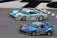 The #66 Porsche 996 of Michael Schrom, Jörg Bergmeister, Timo Bernhard, and Kevin Buckler races to a 7th place finish and the #31 Saleen Ford of  Vic Rice, Gunnar Jeannette, Martin Short, Toni Seiler, and Charles Slater  races to a 17th place finish at the 24 Hours of Daytona, Daytona International Speedway, Daytona Beach, FL, February 3, 2002.  (Photo by Brian Cleary/www.bcpix.com)