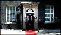 The British Prime Minister David Cameron greets US President Barack Obama on the steps of Number 10 Downing Street, London, On day 2 of his UK tour, Wednesday May 25,2011. Photo By Andrew Parsons/Parsons Media
