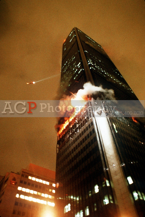 May 05, 1988 - Los Angeles, California, USA - A fire department helicopter flys around the First Interstate Bank Building early Thursday morning, May 5, 1988, as flames shoot from the windows of the 62 storey building. Fire officials described the blaze as one of the worst in the city's history. At least 30 people were injured and one was dead with eight rescued from the roof by helicopter. .(Credit Image: © Alan Greth/Alan Greth)