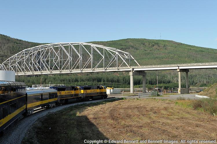 The Alaska Railroad's Denali Star train runs under the Parks Highway at Nenana, south of Fairbanks.