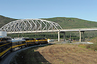 The Alaska Railroad's Denali Star train runs under the Parks Highway at Nenana, south of Fairbanks.