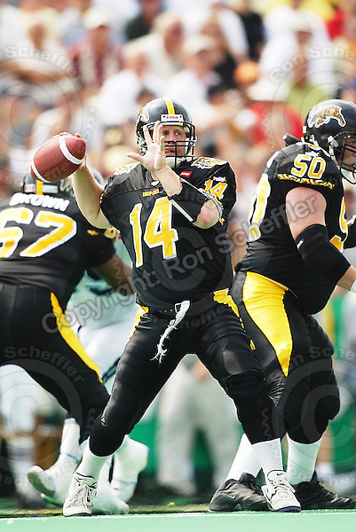 September 2, 2002; Hamilton, Ontario, Canada; Hamilton Tiger-Cats quarterback (14) Danny McManus in action during the Labour Day Classic against the Toronto Argonauts during the 2002 season at Ivor Wynne Stadium. Photo © Ron Scheffler. MANDATORY CREDIT