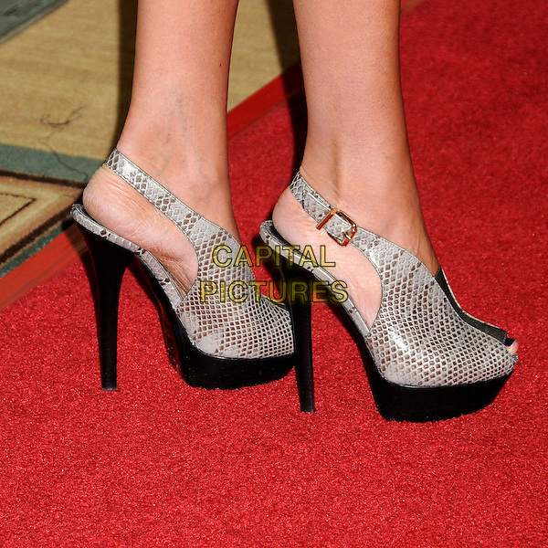 TORI SPELLING's shoes .NBC Universal Press Tour Cocktail Party held at the Langham Hotel, Pasadena, California, USA, 10th January 2010..detail feel black heels slingbacks grey gray platform shoes peep toe snakeskin snake print .CAP/ADM/BP.©Byron Purvis/AdMedia/Capital Pictures.