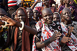 Sunday 5 december 2010 - Juba, Southern Sudan - Fans danced in support of the Dinka wrestlers. Traditional wrestling matches in Juba Stadium between Dinka wrestlers from Yirol East of Lake State and Mundari wrestlers from Terekeka County of Central Equatoria State. The matches attracted large numbers of spectators who sang, played drums and danced in support of their favorite wrestlers. The match organizers hoped that the sport would bring together South Sudan's many different tribes. Photo credit: Benedicte Desrus