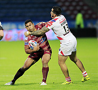 Picture by Chris Mangnall/SWpix.com - 14/07/2017 - Rugby League - Betfred Super League - Huddersfield Giants v Leigh Centurions - John Smith's Stadium, Huddersfield, England -<br /> Huddersfield's Sebastine Ikahihifo  tackled by Leighs Harrison Hansen