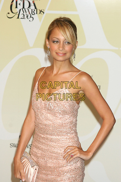 NICOLE RICHIE.2005 CFDA Fashion Awards - Inside Arrivals.New York Public Library in New York City, New York, USA, June 6th 2005 .half length pink sequined beaded dress hand on hip clutch bag .Ref: IW.www.capitalpictures.com.sales@capitalpictures.com.©Ian Wilson/Capital Pictures.
