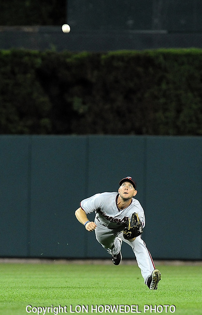 August 20, 2013: Minnesota Twins centerfielder Clete Thomas makes a diving catch of a sinking liner off the bat of Detroit Tiger hitter Andy Dirks to save a pair of runs in the eighth inning of Tuesday night's game between the two teams at Comerica Park in Detroit.