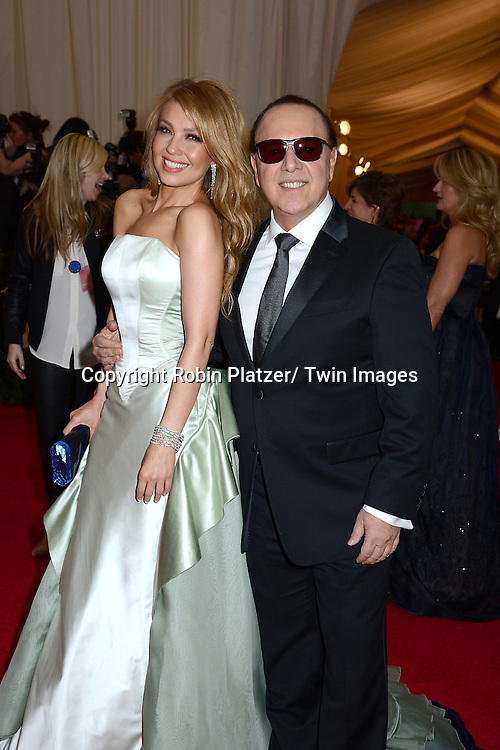Thalia and Tommy Mottola attend the Costume Institute Benefit on May 5, 2014 at the Metropolitan Museum of Art in New York City, NY, USA. The gala celebrated the opening of Charles James: Beyond Fashion and the new Anna Wintour Costume Center.