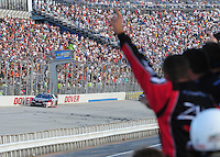 Sept. 20, 2008; Dover, DE, USA; Nascar Nationwide Series driver Kyle Busch takes the checkered flag to win the Camping World RV 200 at Dover International Speedway. Mandatory Credit: Mark J. Rebilas-