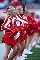 26 September 2009: Nebraska cheerleaders had the 1960's style uniforms to celebrate the 300th consecutive sellout at Memorial Stadium, Lincoln, Nebraska. Nebraska defeats Louisiana Lafayette 55 to 0.