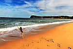 A young girl plays on the shore in  late afternoon at Copacabana Beach on the Central Coast of New South Wales, Sydney, Australia. Photo: (Steve Christo).
