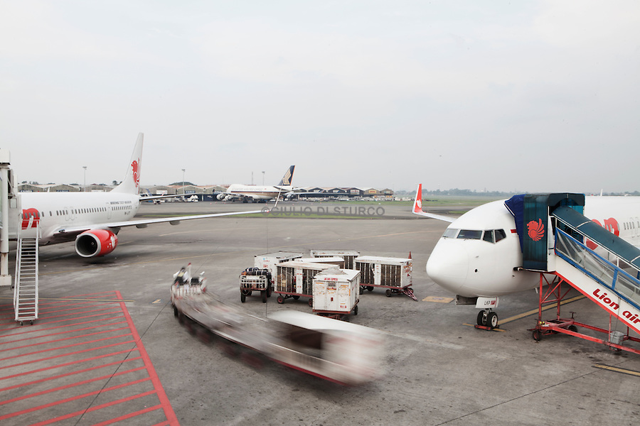 JAKARTA, INDONESIA, MAY 2013:<br /> Lion Air is Indonesia's largest privately run airline, capturing the largest share of the domestic market, May 2013<br /> Jakarta International Airport is the main airport serving the greater Jakarta area on the island of Java, Indonesia.In 2012, the airport was the 9th busiest airport in the world with 57.8 million passengers<br /> <br /> © Giulio Di Sturco for Bloomberg Markets