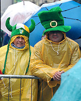 17-3-2014: Protecting against the early rain during the St. Patrick's Day Parade in Killarney County Kerry on Monday.<br /> Picture by Don MacMonagle