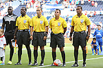 13 July 2015: Match officials (from right): Assistant referee Ricardo Morgan (JAM), Referee Joel Aguilar (SLV), Fourth Official Marlon Mejia (SLV), Garnet Page (JAM), with Johny Placide (HAI) (1). The Haiti Men's National Team played the Honduras Men's National Team at Sporting Park in Kansas City, Kansas in a 2015 CONCACAF Gold Cup Group A match. Haiti won the game 1-0.