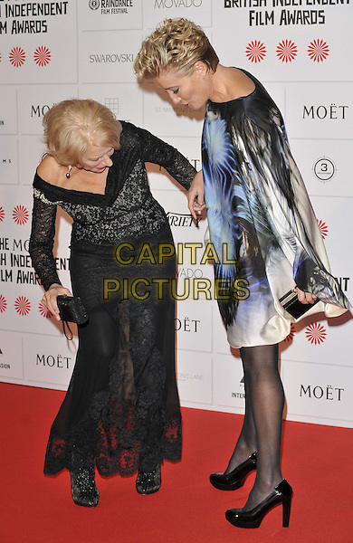 LONDON, ENGLAND - DECEMBER 07: Dame Helen Mirren &amp; Emma Thompson attend the 17th Moet British Independent Film Awards 2014, Old Billingsgate, Old Billingsgate Walk, Lower Thames St., on Sunday December 07, 2014 in London, England, UK.<br /> CAP/CAN<br /> &copy;Can Nguyen/Capital Pictures