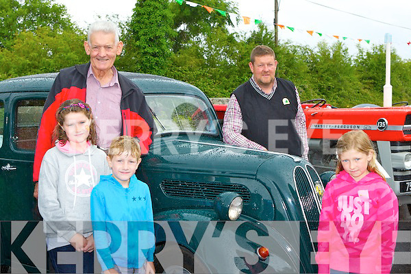 Ava, Leslie, Abbie and Pierce with their dad Tom and grandfather Michael and the Ford Popular car that has been in the family in Listry since 1954