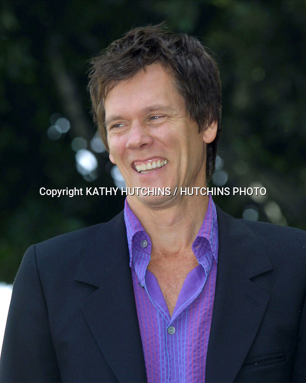 ©2003 KATHY HUTCHINS / HUTCHINS PHOTO.KEVIN BACON RECEIVES A STAR .ON THE HOLLYWOOD WALK  OF FAME.SEPTEMBER 30, 2003..KEVIN BACON
