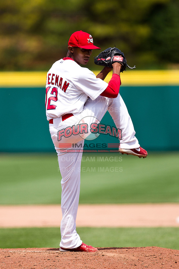 Sam Freeman (12) of the Springfield Cardinals winds up during a game against the Arkansas Travelers at Hammons Field on May 8, 2012 in Springfield, Missouri. (David Welker/ Four Seam Images).