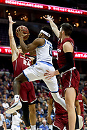 Washington, DC - MAR 10, 2018: Rhode Island Rams guard E.C. Matthews (0) goes up for a lay up ovber Saint Joseph's Hawks forward Pierfrancesco Oliva (24) during the semi final match up of the Atlantic 10 men's basketball championship between Saint Joseph's and Rhode Island at the Capital One Arena in Washington, DC. (Photo by Phil Peters/Media Images International)