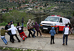 Palestinian protesters pull an ambulance during a demonstration against the expropriation of Palestinian land by Israel in the village of Kfar Qaddum, near the West Bank city of Nablus, on March 2, 2012.  Photo by Wagdi Eshtayah