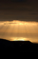 Shafts of sunlight penetrating through cloud banks, over the sea, Tenerife Canary Islands.