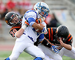 SIOUX FALLS, SD - OCTOBER 16:  Sam Galster #13 from Rapid City Stevens is brought down by Josh Garry #30 and Jack Schelhaas #12 from Washington in the first half of their game Friday night at Howard Wood Field. (Photo by Dave Eggen/Inertia)