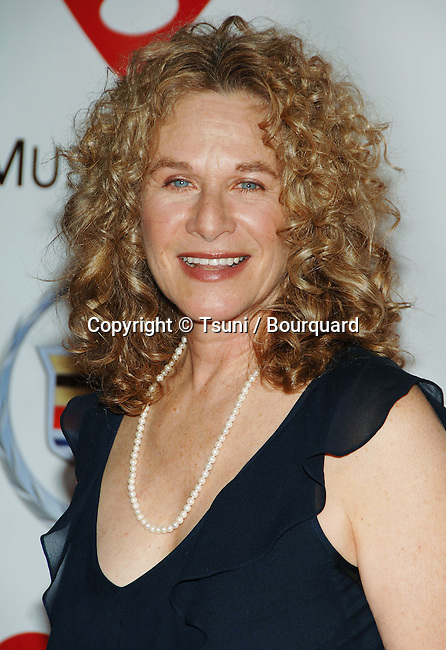 Carole King arriving at the MusiCares Person Of The Year James Taylor at the Convention Center In Los Angeles. February 6, 2006.