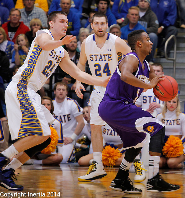 SIOUX FALLS, SD - MARCH 9:  Jabari Sandifer #1 of Western Illinois evades pressure from Chad White #25 of South Dakota State during their first round game at the 2014 Summit League Basketball Championships Sunday at the Sioux Falls Arena.  In the background is Zach Horstman #24 of South Dakota State.  (Photo by Dick Carlson/Inertia)