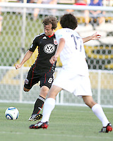 Carey Talley #8 of D.C. United shoots past Kai Kasiguran #17 of the Harrisburg City Islanders during a US Open Cup match at the Maryland Soccerplex on July 21 2010, in Boyds, Maryland. United won 2-0.