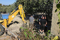 Pictured: Special forensics police officers search a field in Kos, Greece. Wednesday 28 September 2016<br /> Re: Police teams searching for missing toddler Ben Needham on the Greek island of Kos have said they are &quot;optimistic&quot; about new excavation work.<br /> Ben, from Sheffield, was 21 months old when he disappeared on 24 July 1991 during a family holiday.<br /> Digging has begun at a new site after a fresh line of inquiry suggested he could have been crushed by a digger.<br /> South Yorkshire Police (SYP) said it continued to keep an &quot;open mind&quot; about what happened to Ben.
