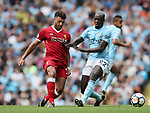 Manchester City's Benjamin Mendy tussles with Liverpool's Alex Oxlade-Chamberlain during the premier league match at the Etihad Stadium, Manchester. Picture date 9th September 2017. Picture credit should read: David Klein/Sportimage
