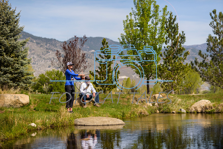 Holly Kuhlmann learns to fly fish with the help her River Buddy Tom Peterson during the Casting for Recovery fishing clinic at Bently Ranch in Gardnerville, Nev. May 4, 2018.<br /> Photo by Candice Vivien/Nevada Momentum
