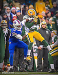 14 December 2014: Green Bay Packers cornerback Tramon Williams intercepts a pass intended for Buffalo Bills wide receiver Sammy Watkins (14) in the second quarter at Ralph Wilson Stadium in Orchard Park, NY. The Bills defeated the Packers 21-13, snapping the Packers' 5-game winning streak and keeping the Bills' 2014 playoff hopes alive. Ed Wolfstein Photo. Original shot Nikon D4 RAW (NEF)