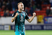 Mike van der Hoorn of Swansea City celebrates his team's win during the Sky Bet Championship match between Charlton Athletic and Swansea City at The Valley, London, England, UK. Wednesday 02 October 2019