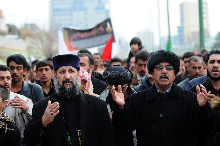 IRAQ, SULAIMANIYAH:  Shia men walk through the streets during Ashura...Around 500 hundred worshipers, many of them internally displaced Arabs, celebrated the Shia holiday of Ashura--the mourning of the death of the grandson of the Islamic prophet Mohammed.  ..Photo by Kamaran Najm/Metrography