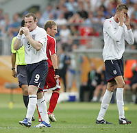 JUNE 15, 2006: Nuremberg, Germany: English forward (9) Wayne Rooney shows his frustration after a missed shot with teammate (21) Peter Crouch. England defeated Trinidad & Tobago, 2-0, in their FIFA World Cup Group B match at Franken-Stadion.
